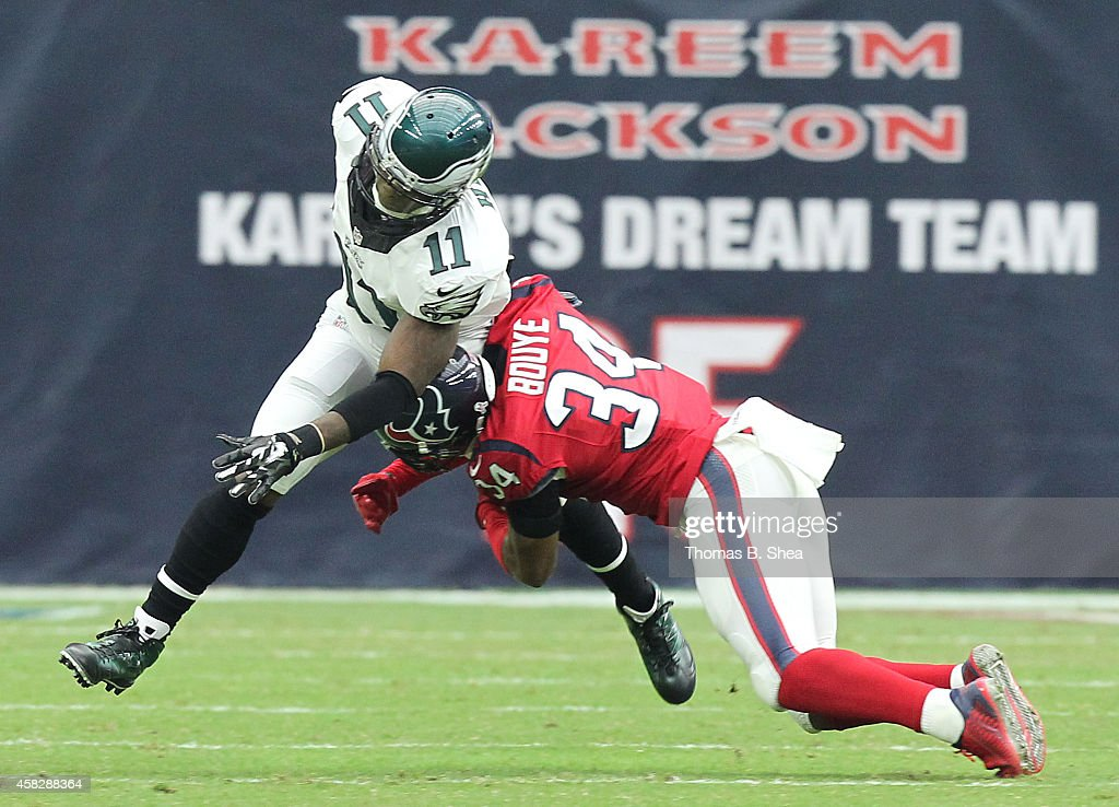 Josh Huff #11 of the Philadelphia Eagles is tackled by A.J. Bouye #34 of the Houston Texans in the first quarter in a NFL game on November 2, 2014 at NRG Stadium in Houston, Texas.