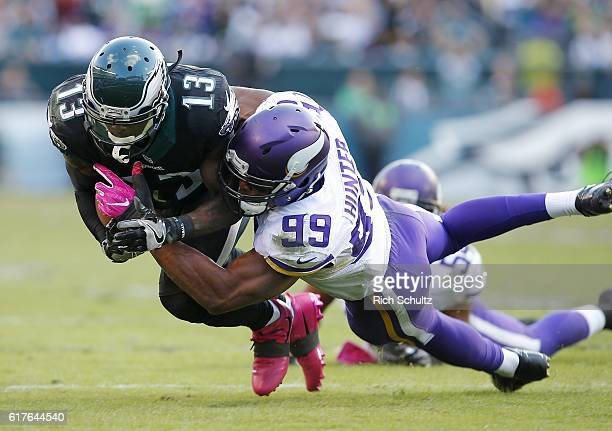 Josh Huff of the Philadelphia Eagles is tackled by Danielle Hunter of the Minnesota Vikings after making a catch for a first down during the fourth...