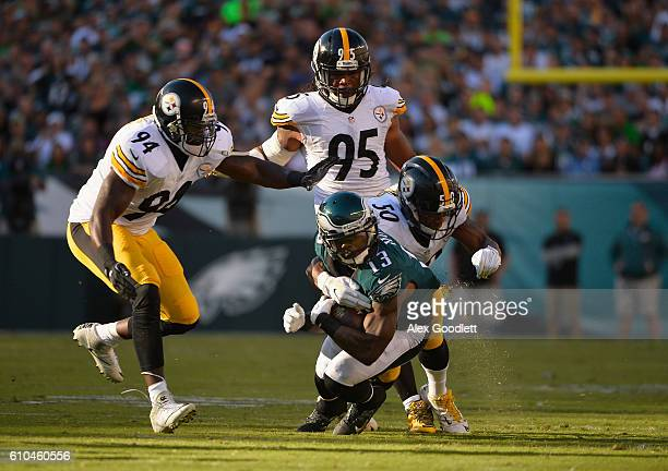Josh Huff of the Philadelphia Eagles is tackled by Ryan Shazier of the Pittsburgh Steelers in the second quarter Lincoln Financial Field on September...