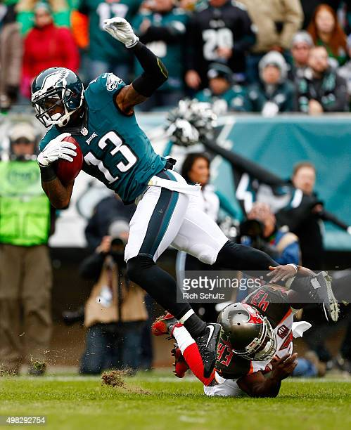 Josh Huff of the Philadelphia Eagles returns the opening kickoff against Bobby Rainey of the Tampa Bay Buccaneers in the first quarter at Lincoln...