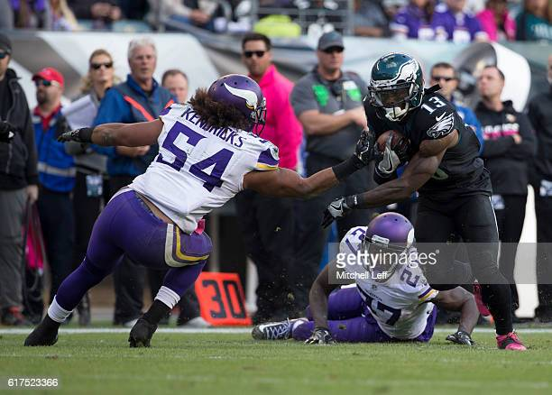 Josh Huff of the Philadelphia Eagles runs with the ball against Jayron Kearse and Eric Kendricks of the Minnesota Vikings in the fourth quarter at...