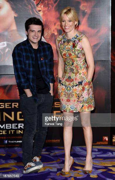 Josh Hutcherson and Elizabeth Banks attend a photocall for 'The Hunger Games Catching Fire' held at the Corinthia Hotel on November 11 2013 in London...