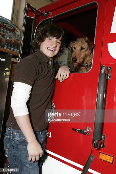 Josh Hutcherson and Rex during 20th Century Fox's AdoptaFireHouse Event in Celebration of the Release of Firehouse Dog at Firehouse 58 in Los Angeles...