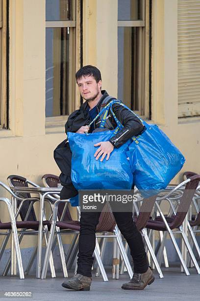 Josh Hutcherson is seen carrying heavy bags to the laundry on February 17 2015 in Madrid Spain