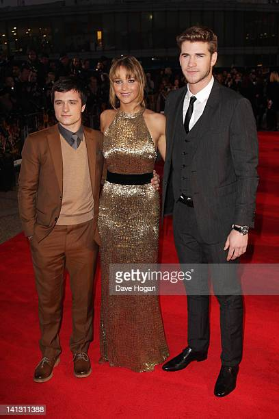 Josh Hutcherson Jennifer Lawrence and Liam Hamsworth attend the European premiere of The Hunger Games at The O2 Arena on March 14 2012 in London...