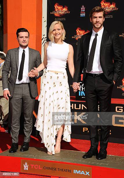 """Josh Hutcherson, Jennifer Lawrence and Liam Hemsworth attend """"The Hunger Games: Mockingjay - Part 2"""" hand and footprint ceremony at TCL Chinese..."""