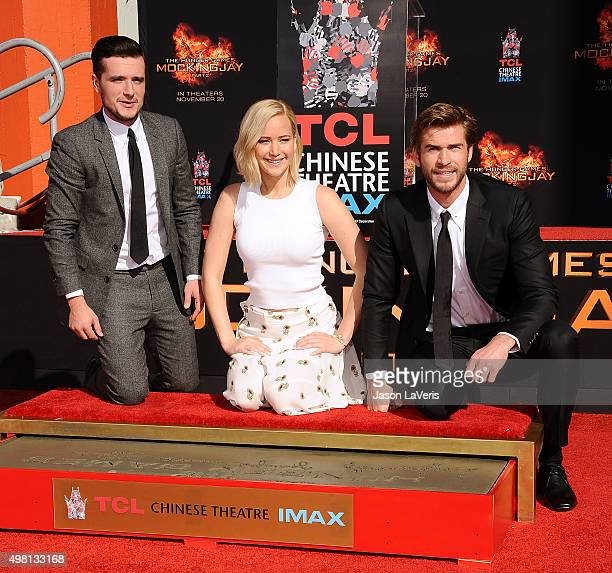 Josh Hutcherson Jennifer Lawrence and Liam Hemsworth attend The Hunger Games Mockingjay Part 2 hand and footprint ceremony at TCL Chinese Theatre on...