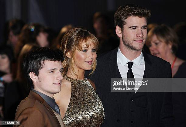 Josh Hutcherson Jennifer Lawrence and Liam Hemsworth attend the European premiere of The Hunger Games at O2 Arena on March 14 2012 in London England
