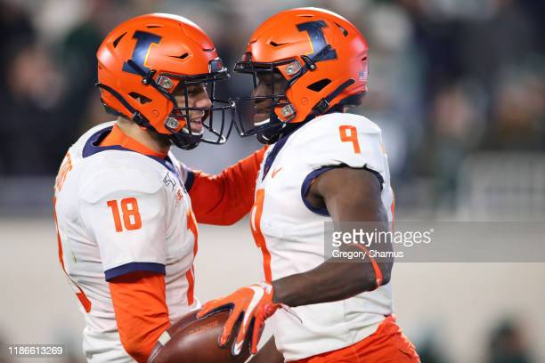 Josh Imatorbhebhe of the Illinois Fighting Illini celebrates his fourth quarter touchdown with Brandon Peters while playing the Michigan State...