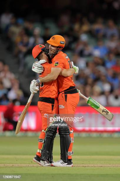 Josh Inglis of the Perth Scorchers and Mitch Marsh of the Perth Scorchers celebrate during the Big Bash League match between the Adelaide Strikers...