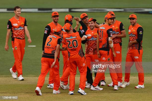 Josh Inglisof the Scorchers celebrates running out Alex Ross of the Thunder during the Big Bash League match between the Perth Scorchers and the...