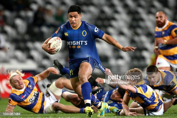 Josh Ioane of Otago breaks the tackle of Richard Judd of Bay of Plenty during the round eight Mitre 10 Cup match between Otago and Bay of Plenty at...
