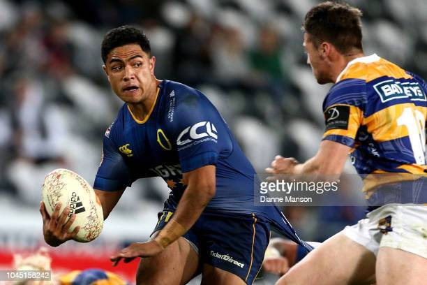 Josh Ioane of Otago looks to fend off Kaleb Trask of Bay of Plenty during the round eight Mitre 10 Cup match between Otago and Bay of Plenty at...