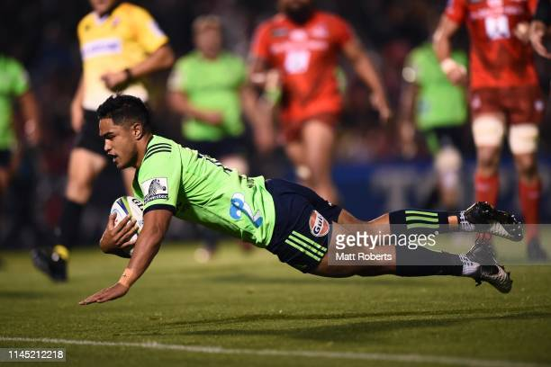 Josh Ioane of the Highlanders dives to score his side's fourth try during the round 11 Super Rugby match between Sunwolves and Highlanders at the...