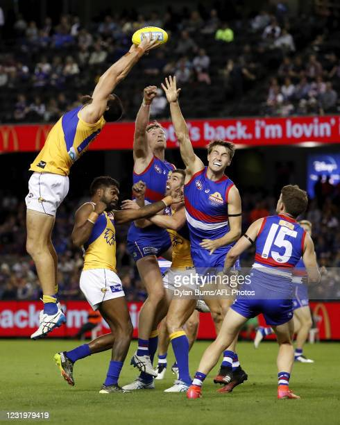 Josh J. Kennedy of the Eagles marks the ball over Liam Ryan of the Eagles, Jack Darling of the Eagles, Alex Keath of the Bulldogs and Ryan Gardner of...