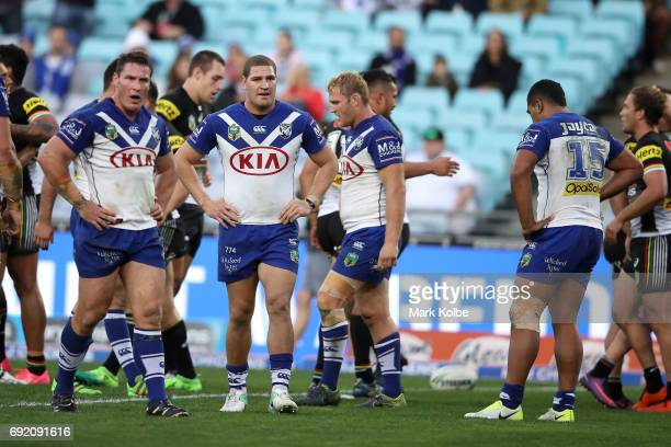 Josh Jackson and Brenko Lee of the Bulldogs looks dejected after a Panthers try during the round 13 NRL match between the Canterbury Bulldogs and the...