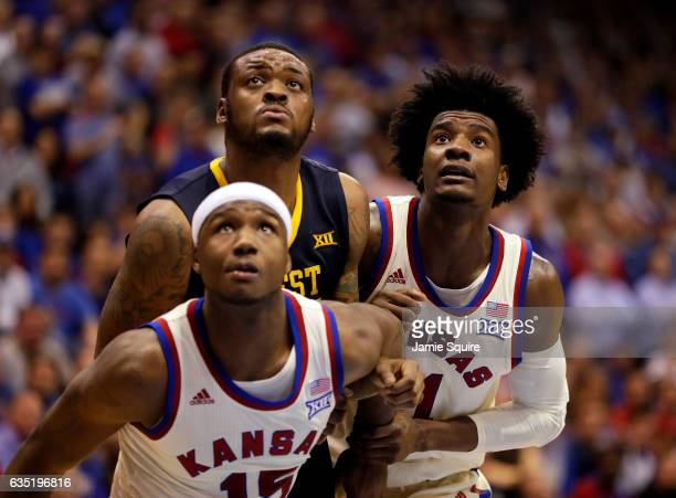 Josh Jackson and Carlton Bragg Jr #15 of the Kansas Jayhawks box out Elijah Macon of the West Virginia Mountaineers during the game at Allen...