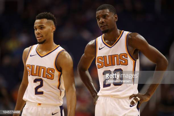 Josh Jackson and Elie Okobo of the Phoenix Suns stand on the court during the first half of the NBA game against the New Zealand Breakers at Talking...