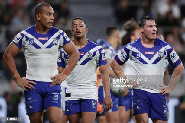 Josh Jackson, Brendon Wakeham and Will Hopoate of the Bulldogs look dejected during the round 1 NRL match between the Parramatta Eels and the...