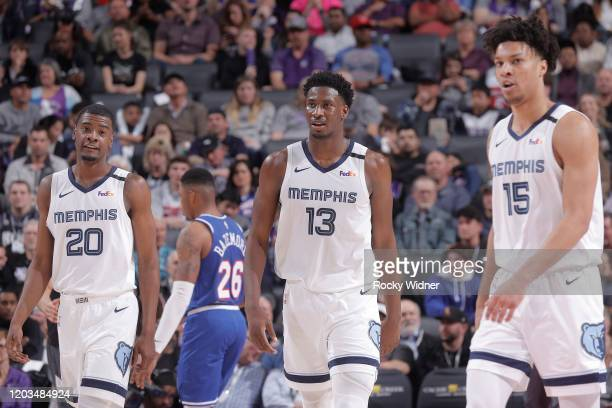 Josh Jackson Jaren Jackson Jr #13 and Brandon Clarke of the Memphis Grizzlies look on during the game against the Sacramento Kings on February 20...