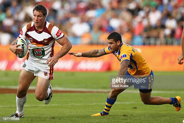 Josh Jackson of Country beats the tackle of Adam Reynolds of City during the Origin match between City and Country at BCU International Stadium on...