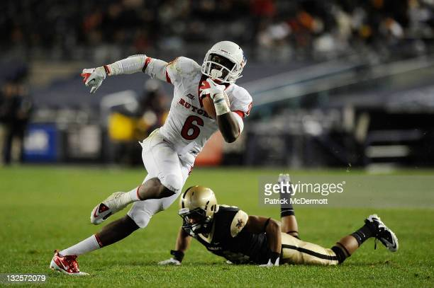 Josh Jackson of the Army Black Knights misses a tackle against Mohamed Sanu of the Rutgers Scarlet Knights during a game at Yankee Stadium on...