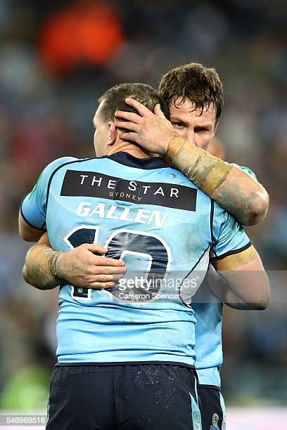 Josh Jackson of the Blues embraces Paul Gallen of the Blues after game three of the State Of Origin series between the New South Wales Blues and the...