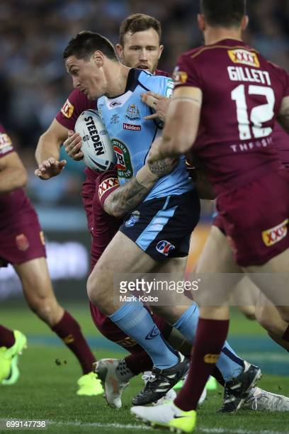 Josh Jackson of the Blues is tackled during game two of the State Of Origin series between the New South Wales Blues and the Queensland Maroons at...