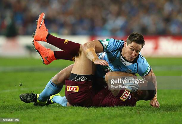 Josh Jackson of the Blues tackles Darius Boyd of the Maroons during game one of the State Of Origin series between the New South Wales Blues and the...