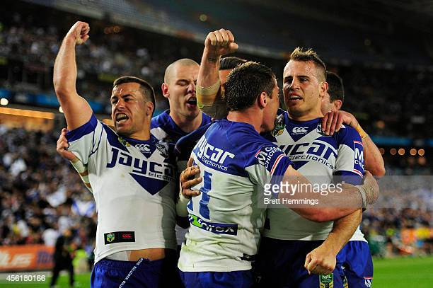 Josh Jackson of the Bulldogs celebrates scoring a try with team mates during the NRL Second Preliminary Final match between the Penrith Panthers and...