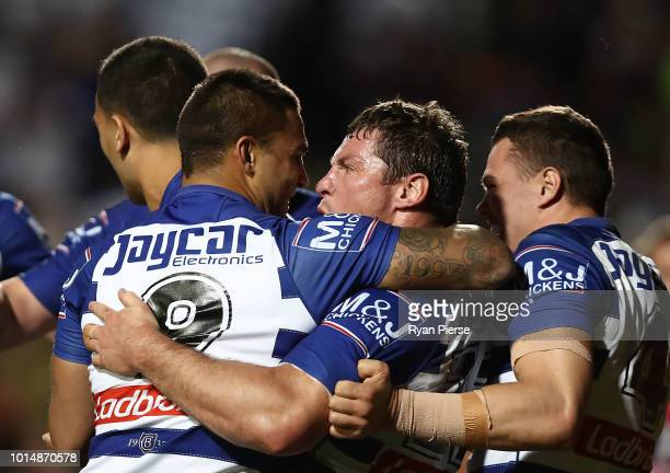 Josh Jackson of the Bulldogs celebrates with Michael Lichaa of the Bulldogs after Reimis Smith of the Bulldogs scored a try during the round 22 NRL...