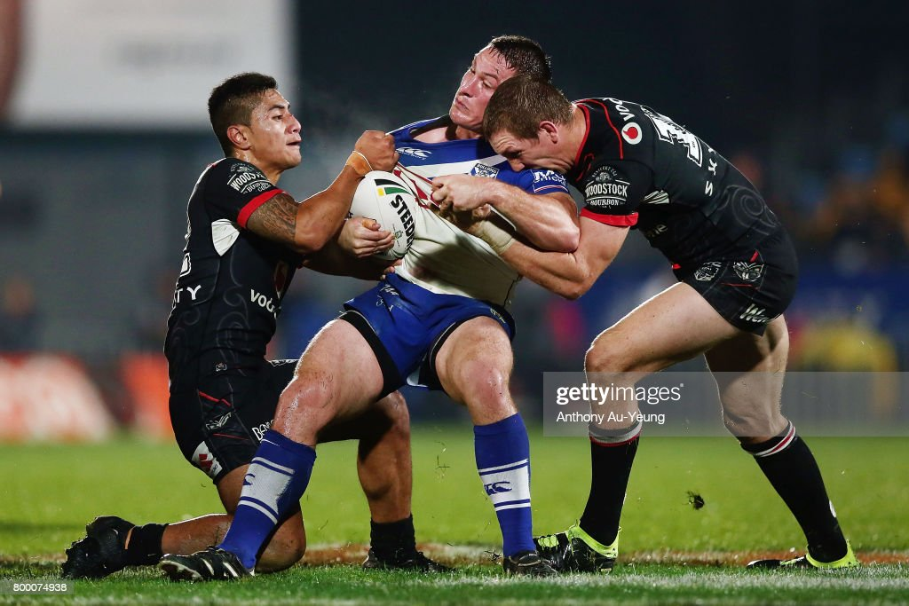 Josh Jackson of the Bulldogs is tackled by Ata Hingano and Ryan Hoffman of the Warriors during the round 16 NRL match between the New Zealand Warriors and the Canterbury Bulldogs at Mt Smart Stadium on June 23, 2017 in Auckland, New Zealand.