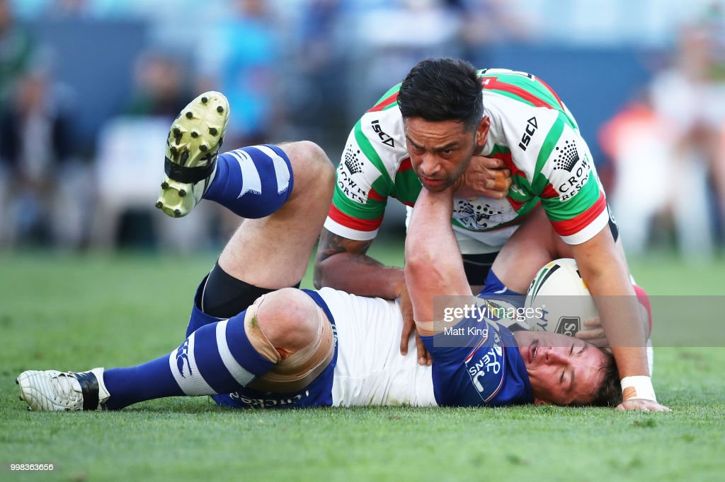 Josh Jackson of the Bulldogs is tackled by John Sutton of the Rabbitohs during the round 18 NRL match between the Canterbury Bulldogs and the South Sydney Rabbitohs at ANZ Stadium on July 14, 2018 in Sydney, Australia.