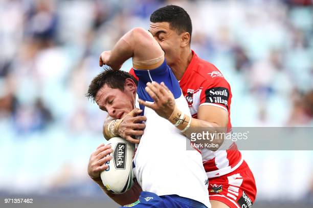 Josh Jackson of the Bulldogs is tackled by Tim Lafai of the Dragons during the round 14 NRL match between the Canterbury Bulldogs and the St George...