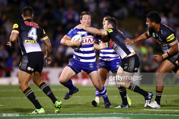 Josh Jackson of the Bulldogs is tackled during the NRL round eight match between the Penrith Panthers and Canterbury Bulldogs on April 27 2018 in...