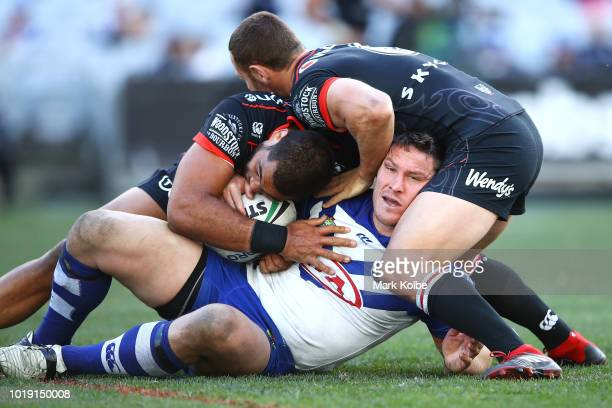 Josh Jackson of the Bulldogs is tackled during the round 23 NRL match between the Canterbury Bulldogs and the New Zealand Warriors at ANZ Stadium on...