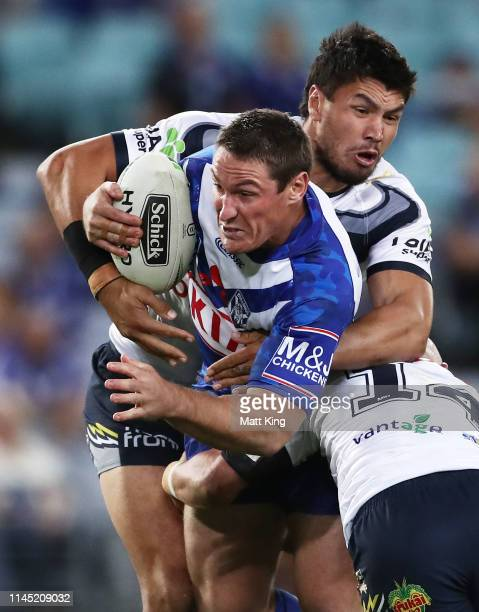 Josh Jackson of the Bulldogs is tackled during the round 7 NRL match between the Canterbury Bulldogs and the North Queensland Cowboys at ANZ Stadium...