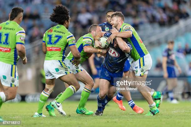 Josh Jackson of the Bulldogs is tackled during the round nine NRL match between the Canterbury Bulldogs and the Canberra Raiders at ANZ Stadium on...