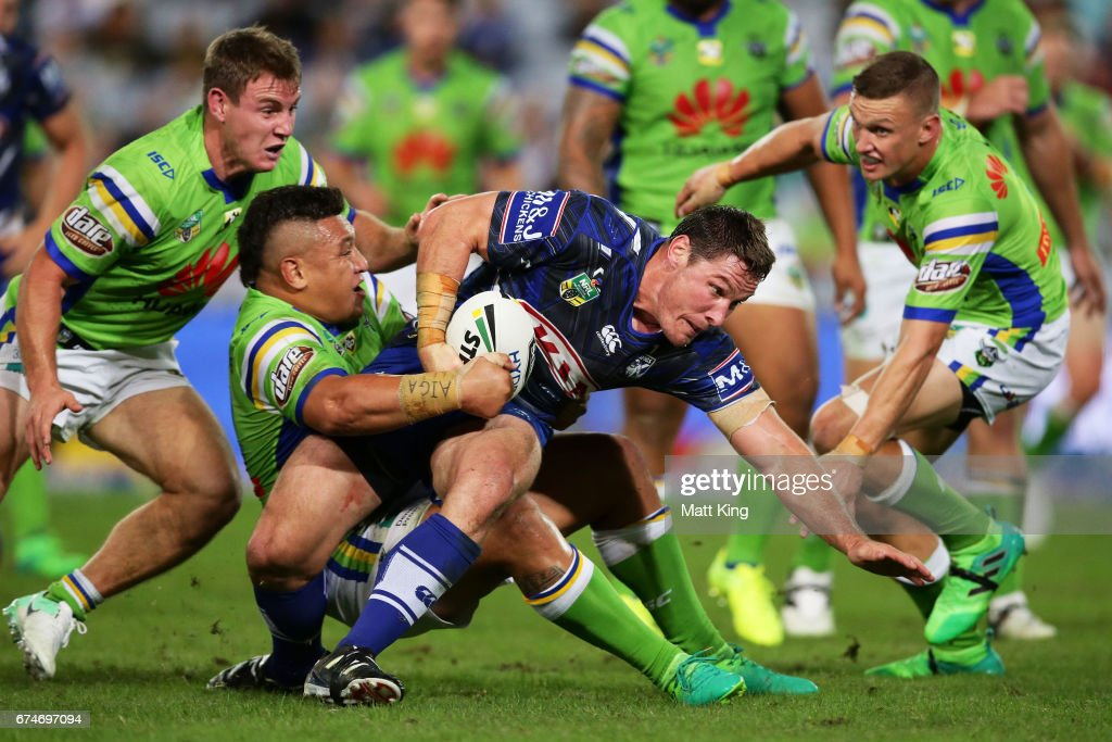 Josh Jackson of the Bulldogs is tackled just short of the line during the round nine NRL match between the Canterbury Bulldogs and the Canberra Raiders at ANZ Stadium on April 29, 2017 in Sydney, Australia.