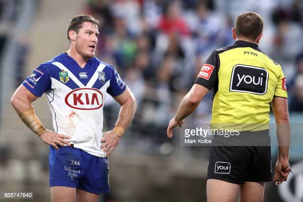Josh Jackson of the Bulldogs looks at referee Ben Cummins during the round 24 NRL match between the Canterbury Bulldogs and the Manly Sea Eagles at...