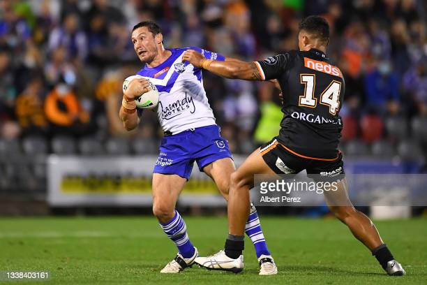 Josh Jackson of the Bulldogs takes on the West Tigers defence during the round 25 NRL match between the Wests Tigers and the Canterbury Bulldogs at...