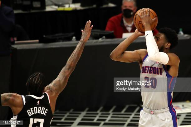 Josh Jackson of the Detroit Pistons drives to the basket against Paul George of the Los Angeles Clippers during the third quarter at Staples Center...