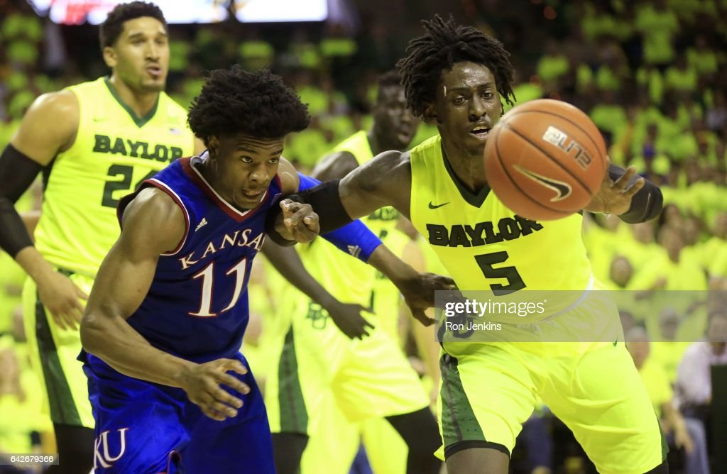 Josh Jackson #11 of the Kansas Jayhawks and Johnathan Motley #5 of the Baylor Bears compete for a loose ball in the second half at the Ferrell Center on February 18, 2017 in Waco, Texas. Kansas won 67-65.