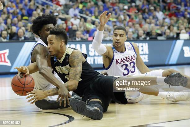 Josh Jackson of the Kansas Jayhawks and Vince Edwards of the Purdue Boilermakers battle for a loose ball in the second half during the 2017 NCAA...