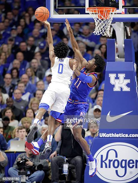 Josh Jackson of the Kansas Jayhawks defends the shot of De'Aaron Fox of the Kentucky Wildcats during the game against at Rupp Arena on January 28...