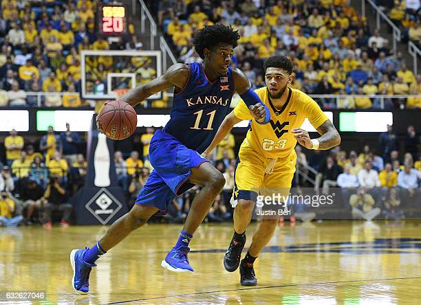 Josh Jackson of the Kansas Jayhawks drives to the basket against Esa Ahmad of the West Virginia Mountaineers in the second half during the game at...