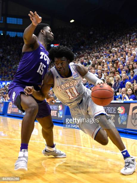 Josh Jackson of the Kansas Jayhawks drives to the basket against JD Miller of the TCU Horned Frogs in the first half at Allen Fieldhouse on February...