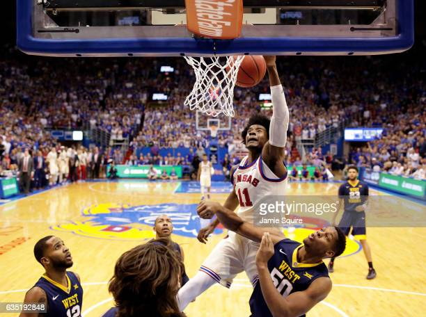 Josh Jackson of the Kansas Jayhawks dunks during the game against the West Virginia Mountaineers at Allen Fieldhouse on February 13 2017 in Lawrence...