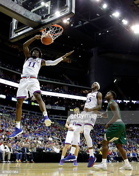 Josh Jackson of the Kansas Jayhawks dunks on a fast break during the CBE Hall of Fame Classic game against the UAB Blazers at the Sprint Center on...
