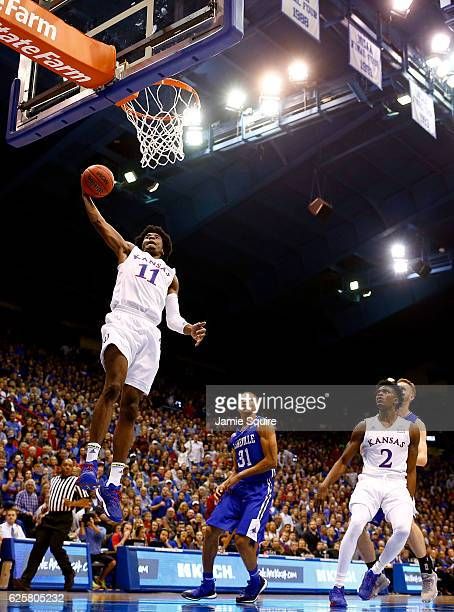 Josh Jackson of the Kansas Jayhawks dunks on a fast break during the game against the North CarolinaAsheville Bulldogs at Allen Fieldhouse on...